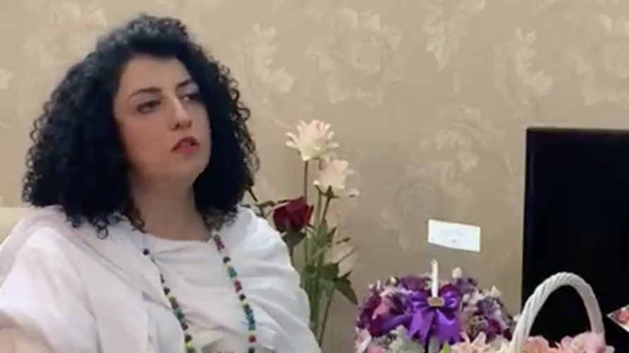 In this screen grab of a Twitter video posted by her husband Taghi Rahmani, Iranian human rights activist Narges Mohammadi is seen at her parents' home in Iran, hours after being released from a Zanjan prison on October 8, 2020. (Twitter)