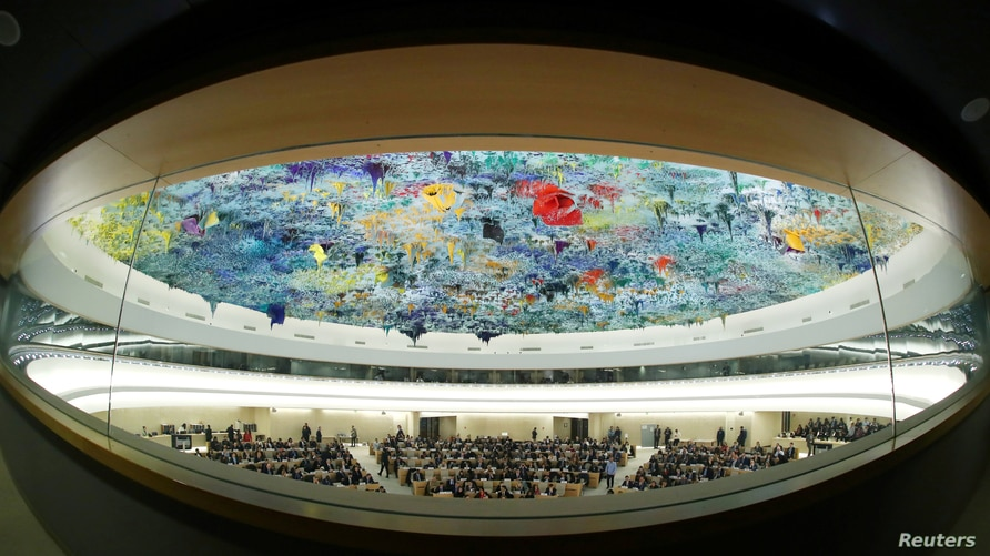 FILE - A fisheye view of the session of the Human Rights Council during a speech by U.N. High Commissioner for Human Rights Michelle Bachelet at the United Nations in Geneva, Switzerland, Feb. 27, 2020.