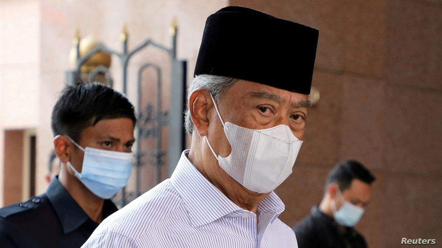 FILE - Malaysia's Prime Minister Muhyiddin Yassin, wearing a mask to protect against the coronavirus, arrives at a mosque for prayers, in Putrajaya, Malaysia, Aug. 28, 2020.