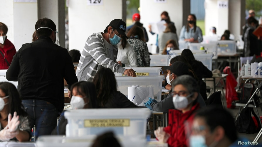 A man casts a ballot during a referendum on a new Chilean constitution in Santiago, Chile, Oct. 25, 2020.