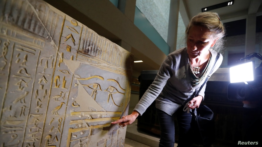 Friederike Seyfried, Director of the Egyptian Museum and Papyrus Collection in Berlin, Germany, shows damages after unknown perpetrators damaged numerous pieces of art and antiques at the museum island, Oct. 21, 2020.