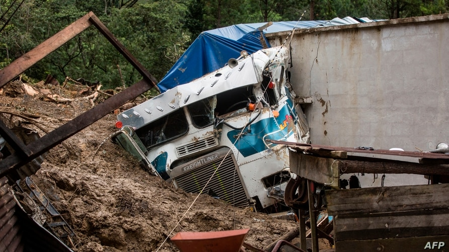 A truck is covered by mud at the side of a musdlide caused by the passage of Hurricane Eta in the village of Queja, in San…