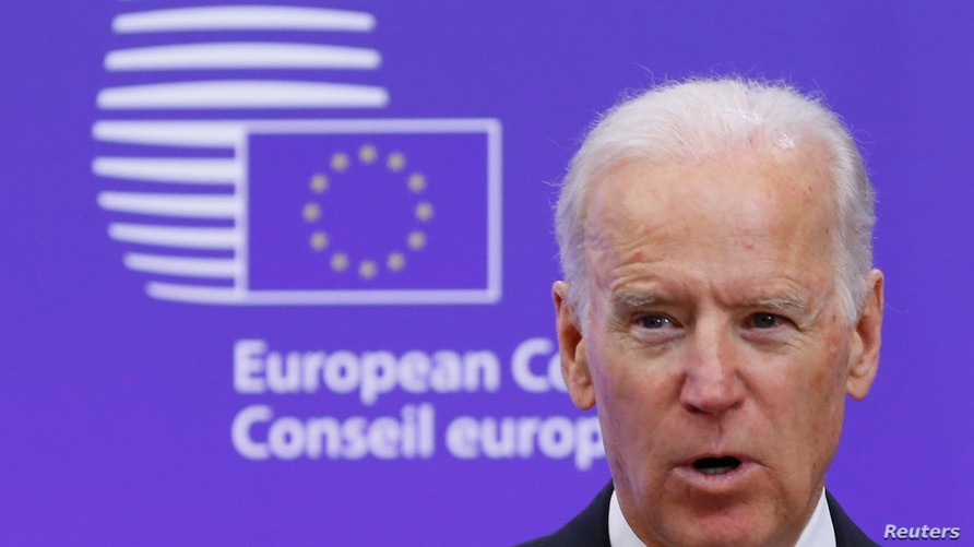 U.S. Vice President Joe Biden makes a joint statement with European Council President Donald Tusk ahead of a meeting at EU…