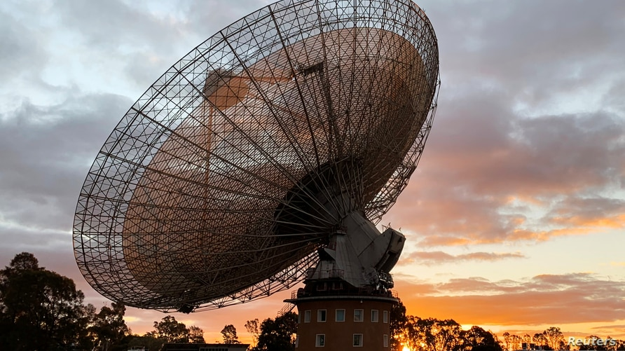 The radio telescope at the Parkes Observatory is pictured at sunset near the town of Parkes, Australia July 15, 2019. Picture…