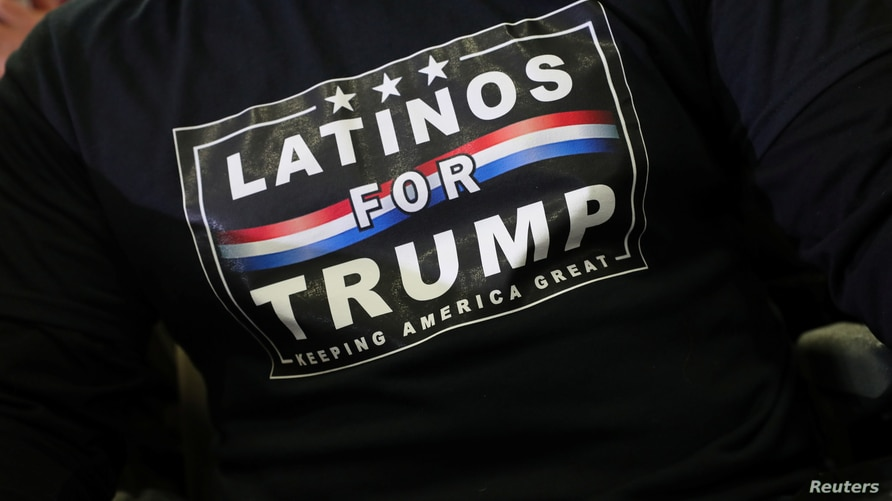 """A supporter wearing a """"Latinos for Trump"""" T-shirt attends U.S. President Donald Trump's campaign rally in Wildwood, New Jersey,…"""