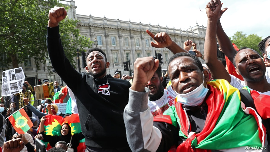 People gather to protest against the treatment of Ethiopia's ethnic Oromo group, outside Downing Street in London, Britain,…