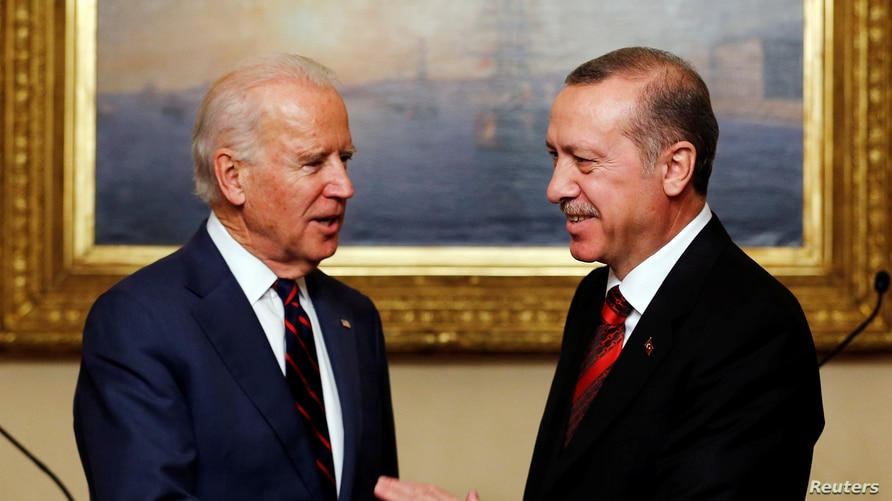 FILE - Then U.S. Vice President Joe Biden (L) meets with Turkey's President Tayyip Erdogan in Istanbul.