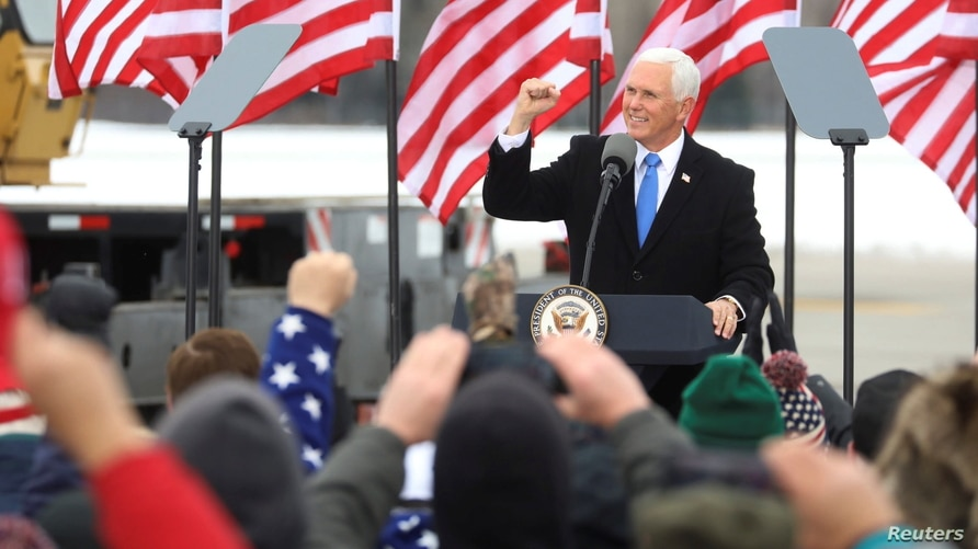U.S. Vice President Mike Pence speaks to supporters at a pre-election rally in Hibbing, Minnesota, U.S. October 26, 2020. Steve…