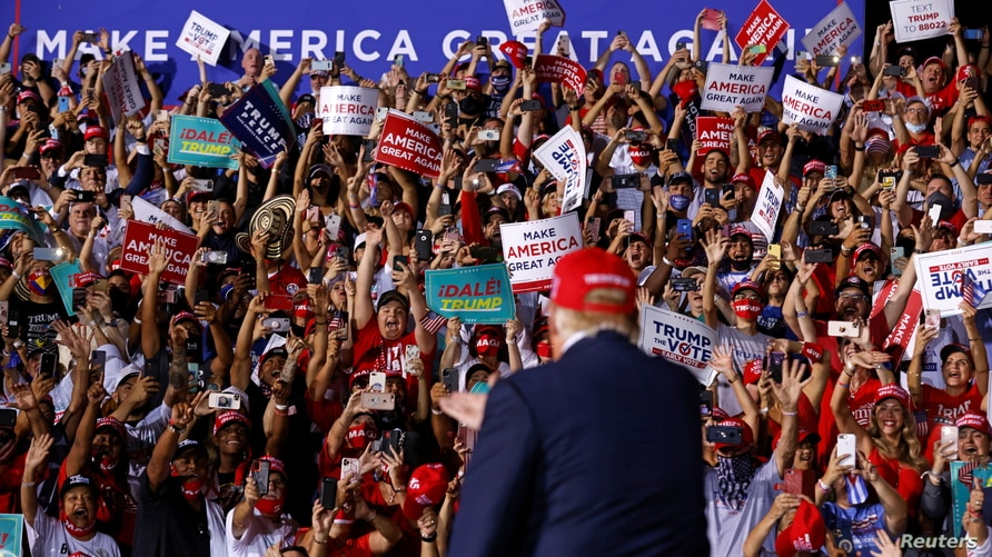 U.S. President Donald Trump arrives at a campaign rally at Miami-Opa Locka Executive Airport in Opa-Locka, Florida, U.S.,…