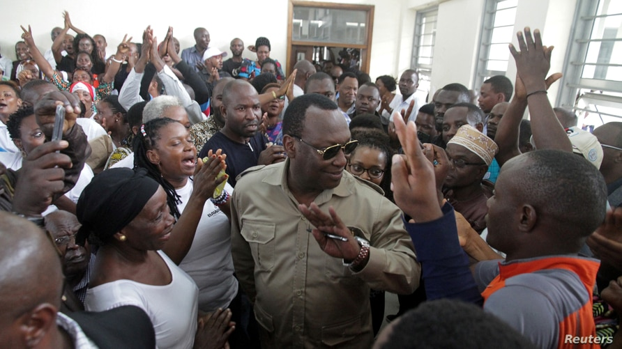 FILE PHOTO: Freeman Mbowe (C), chairman of Chadema, Tanzanian main opposition party arrives at Kisutu Magistrate Court in Dar…