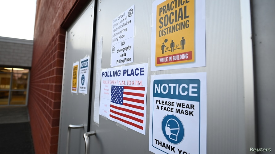 Warning signs are seen outside Highland Elementary School during the U.S. presidential election in Ambridge, Beaver County,…