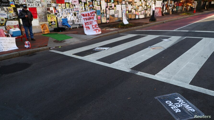 A sign is stuck on a street at Black Lives Matter Plaza after early results of the 2020 U.S. presidential election were…