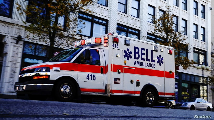 A Bell Ambulance speeds through the Bronzeville neighborhood on the North Side of Milwaukee, as the coronavirus disease (COVID…