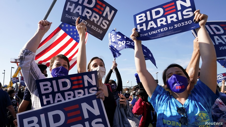 Supporters of Democratic U.S. presidential nominee Joe Biden celebrate near the site of his planned victory celebration.