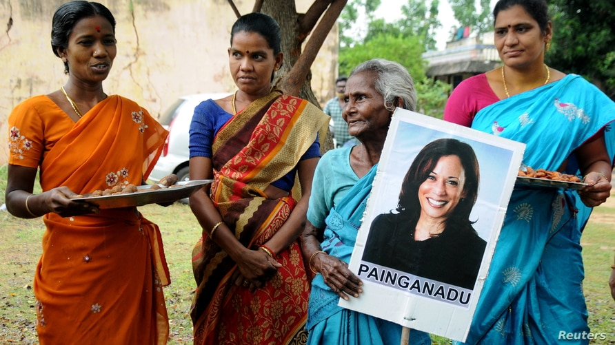 Women gather to celebrate the victory of U.S. Vice President-elect Kamala Harris in Painganadu near the village of…