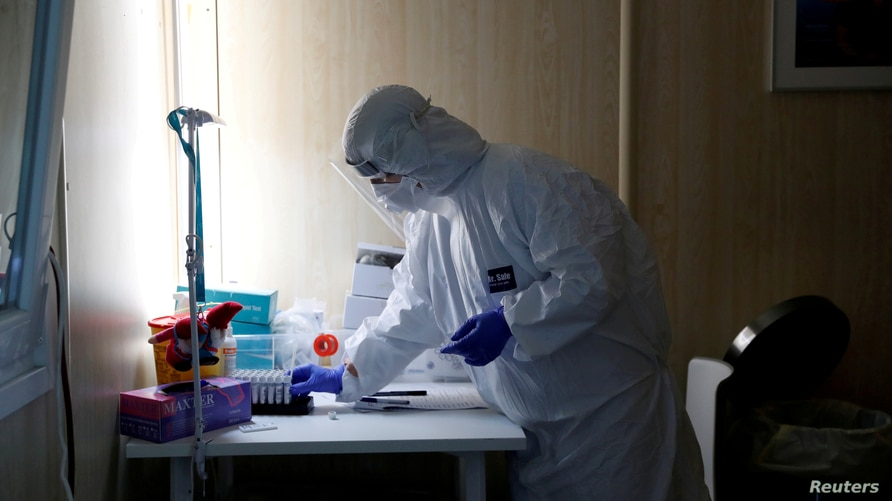 FILE PHOTO: A healthcare worker works at a COVID-19 testing site as the spread of the coronavirus disease (COVID-19) continues…