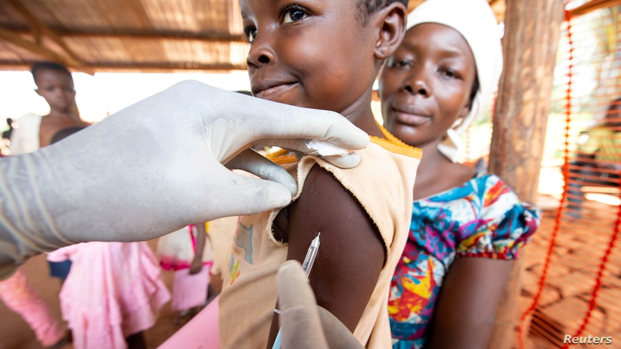 FILE - A child is given a measles vaccination during an emergency campaign run by Doctors Without Borders (MSF) in DRC.