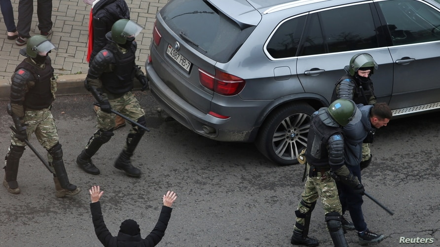 A demonstrator is taken away by Belarusian law enforcement officers during a rally to reject the presidential election results…