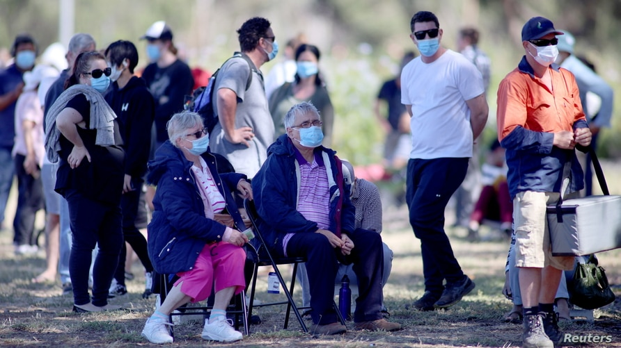 People are seen queuing at a coronavirus disease (COVID-19) testing site as the state of South Australia experiences an outbreak, in Adelaide, Australia, Nov. 17, 2020.