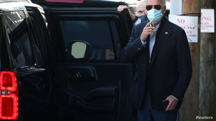 U.S. President-elect Joe Biden exits The Queen theatre following a virtual meeting with frontline healthcare workers in Wilmington, Delaware, Nov. 18, 2020.