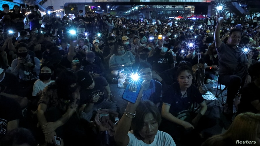 Protesters attend a pro-democracy rally demanding the prime minister to resign and reforms of the monarchy, in Bangkok, Thailand, Nove. 27, 2020.