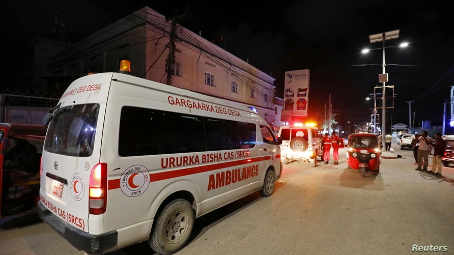 An ambulance is seen at the site of a blast at an ice-cream parlour in Mogadishu, Somalia, Nov. 27, 2020.