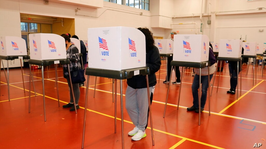 Maryland voters cast their ballots on Tuesday, Nov. 3, 2020 at the Pip Moyer Recreation Center in Annapolis, Md.  (AP Photo…