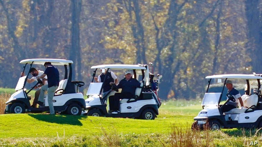 President Donald Trump participates in a round of golf at the Trump National Golf Course on Saturday, Nov. 7, 2020, in Sterling…