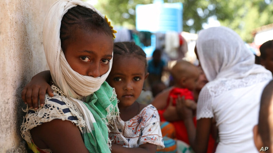 Refugees from the Tigray region of Ethiopia region wait to register at the UNCHR center at Hamdayet, Sudan on Saturday, Nov. 14…