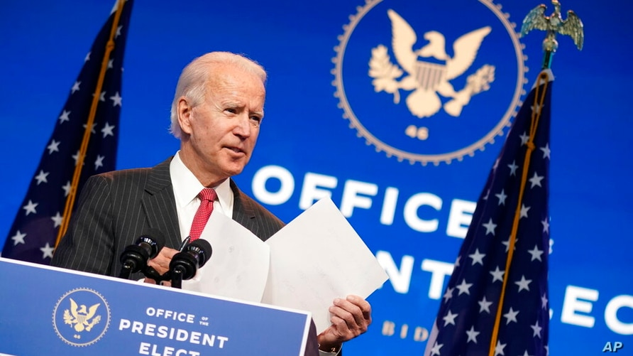 President-elect Joe Biden, accompanied by Vice President-elect Kamala Harris, speaks at The Queen theater, Thursday, Nov. 19,…