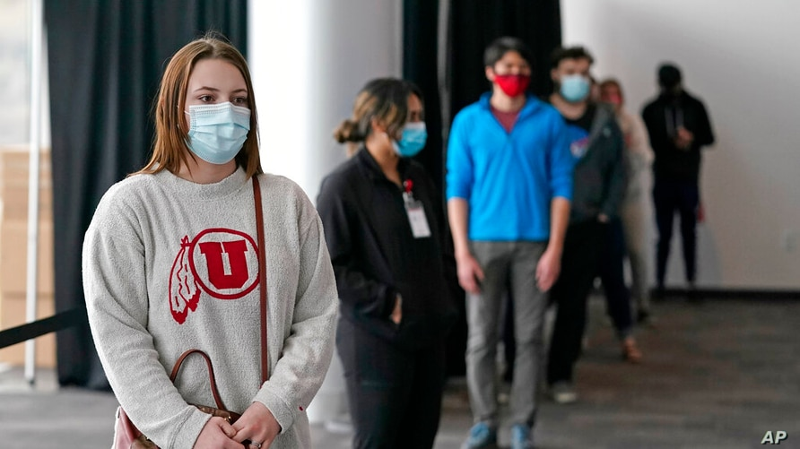 University of Utah student Abigail Shull waits in line before taking a rapid COVID-19 test at the University of Utah student…