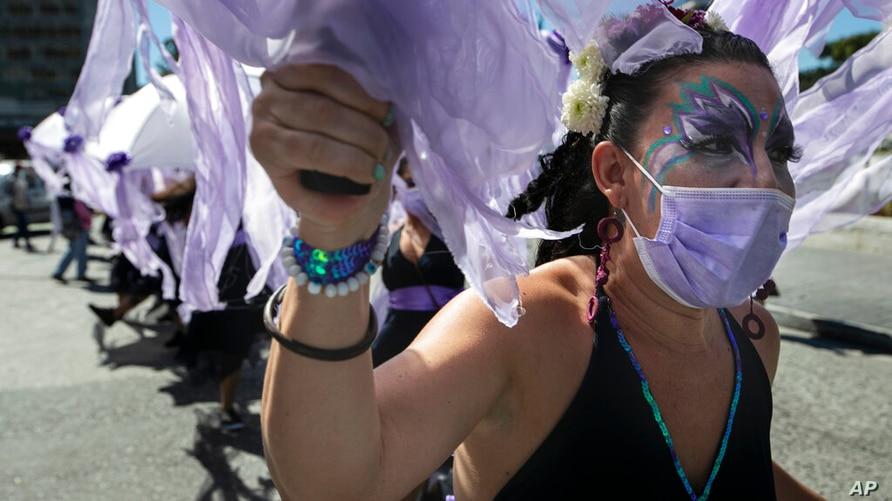 A woman takes part in a demonstration marking the International Day for the Elimination of Violence against Women, in Guatemala…