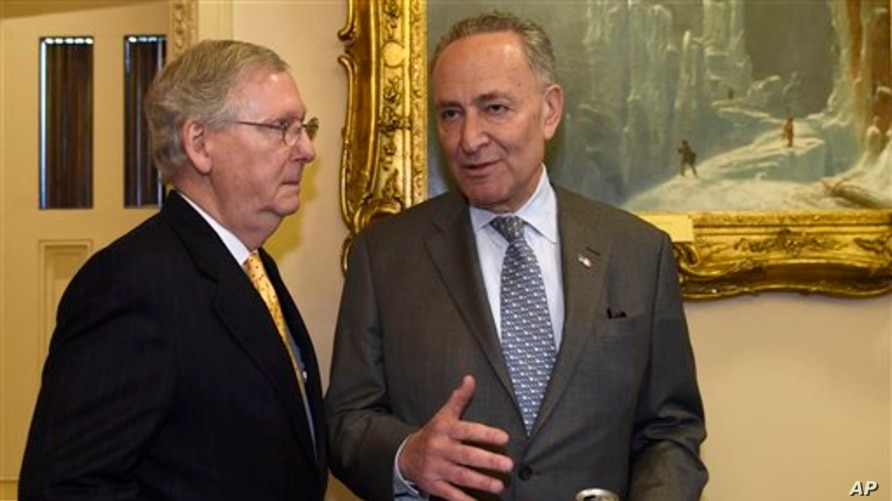 Senate Majority Leader Mitch McConnell of Ky., left, talks with Sen. Charles Schumer, D-N.Y., on Capitol Hill in Washington,…