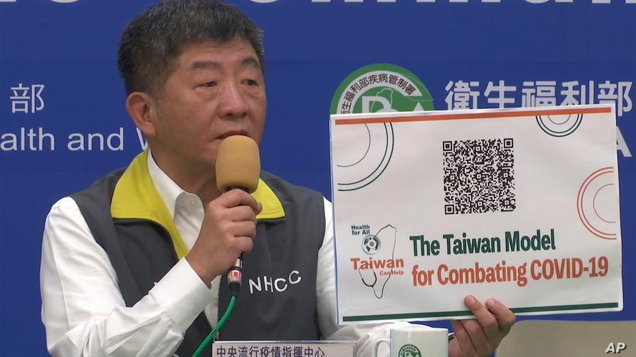 In this image made from a video, Taiwan's Health Minister Chen Shih-chung speaks at a press conference in Taipei, Taiwan…