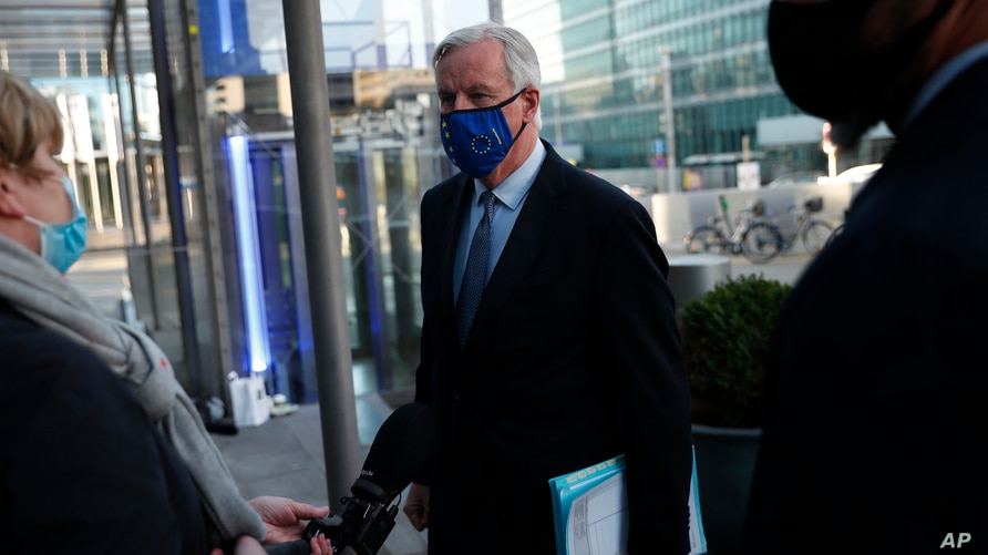 European Commission's Head of Task Force for Relations with the United Kingdom Michel Barnier talks to journalists as he leaves…
