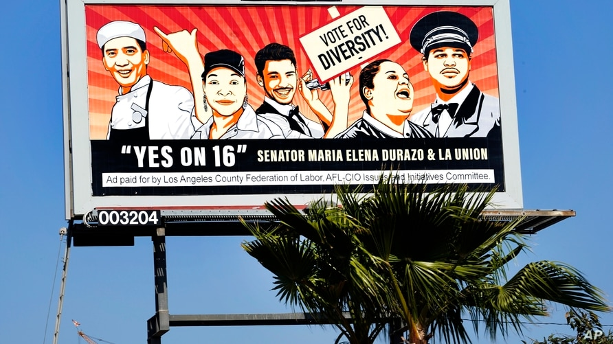 This Friday, Oct. 30, 2020, photo shows a billboard ad for the 2020 California Proposition 16 - End Diversity Ban, in Inglewood…
