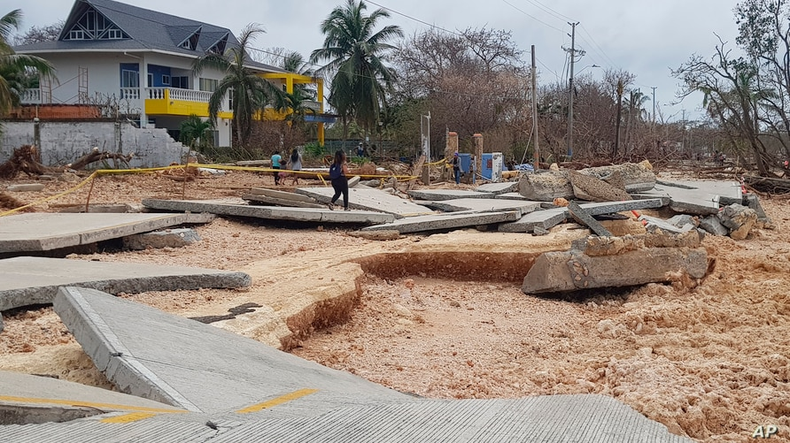 A road that runs along the shore lays in pieces after the passing of Hurricane Iota on San Andres Island, Colombia, Tuesday,…