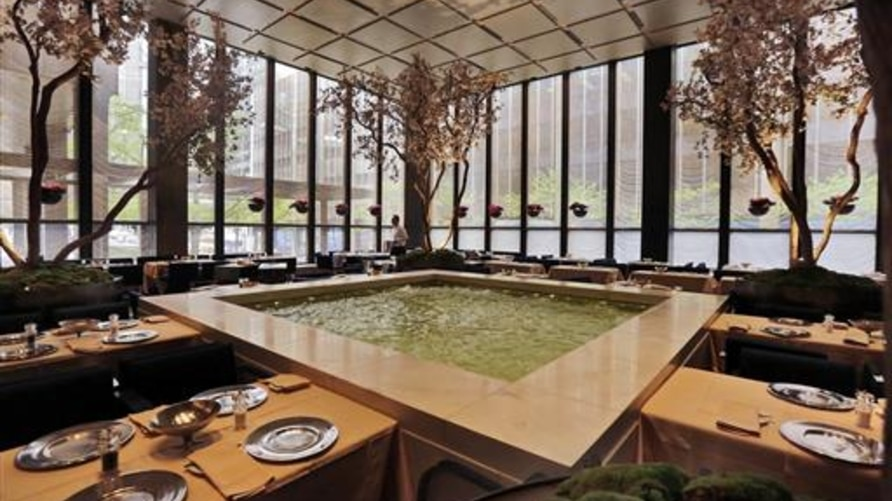 In this April 29, 2016 photo, spring blossoming trees adorn the Pool Room dining area of The Four Seasons restaurant, which opened in 1959 and closed in 2016.