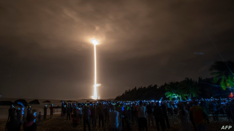 A Long March 5 rocket carrying China's Chang'e-5 lunar probe launches from the Wenchang Space Center on China's southern Hainan Island, Nov. 24, 2020, on a mission to bring back lunar rocks.