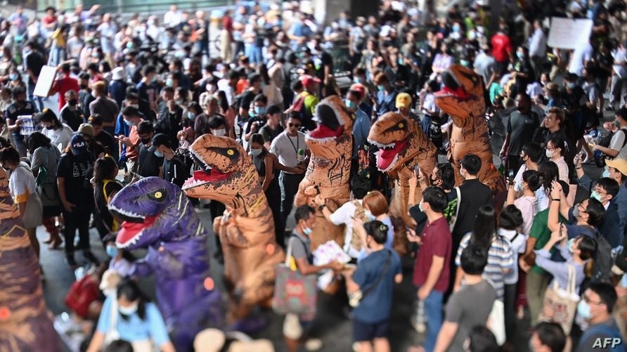 A photo taken with a tilt-shift lens shows protesters dressed in dinosaur costumes, which pro-democracy activists said represent the older generation of Thai politicians, during a 'Bad Student' rally in Bangkok, Thailand, Nov. 21, 2020.