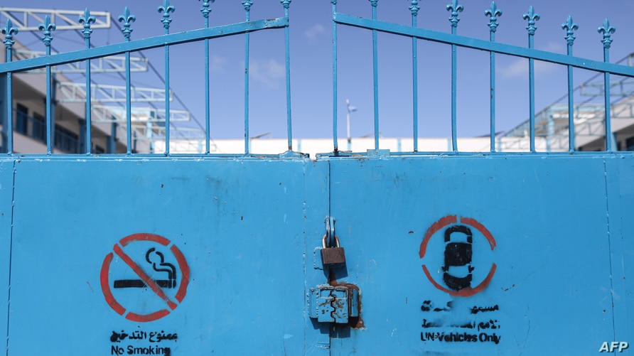 FILE - Locked gates are seen at a shuttered school run by the United Nations Relief and Works Agency (UNRWA) in Gaza City, in the Palestinian territories, March 7, 2020.