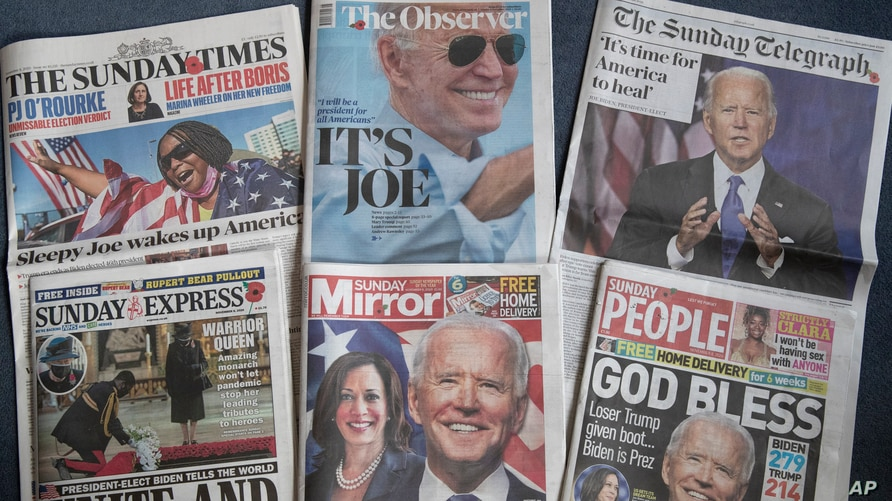 A selection of the British national newspapers with front page reactions to President-elect Joe Biden and Vice President-elect Kamala Harris prevailing in the U.S. election, is seen in London, Nov. 8, 2020.