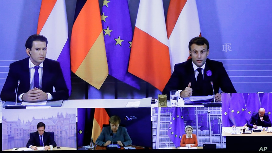 French President Emmanuel Macron, right, and Austria's Chancellor Sebastian Kurz, left, speak via videoconference shown on a screen in the European Council building in Brussels, Belgium, Nov. 10, 2020.