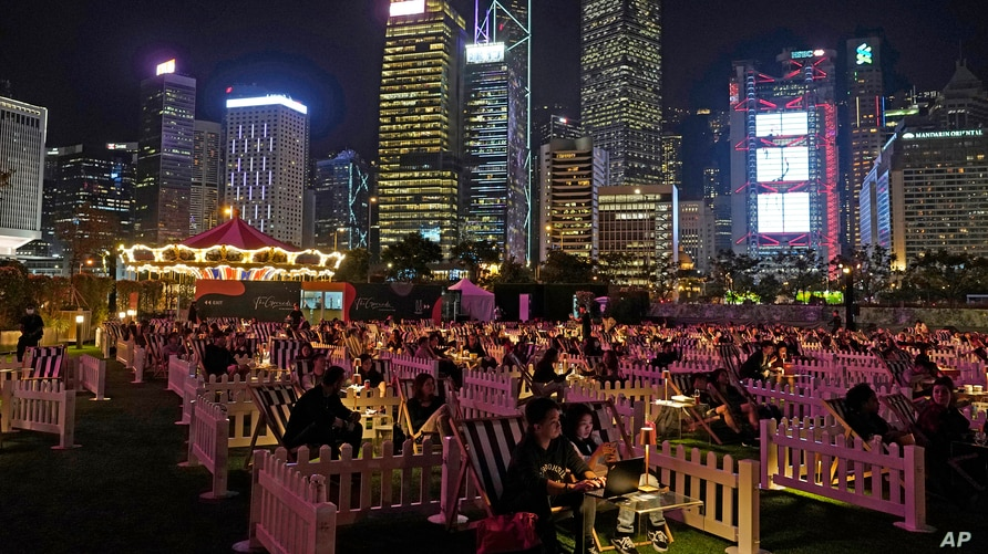 People watch a movie in an outdoor park in Hong Kong.