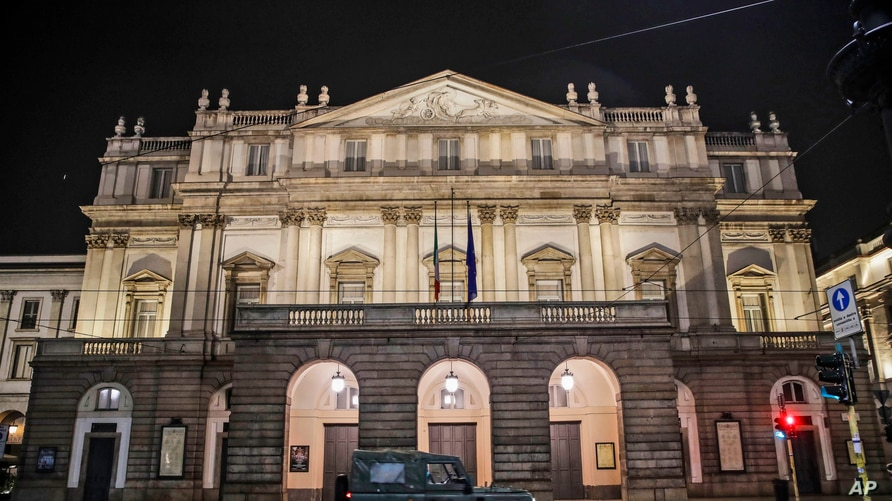 FILE - A military vehicle drives past La Scala opera theater in Milan, northern Italy, Oct. 25, 2020.