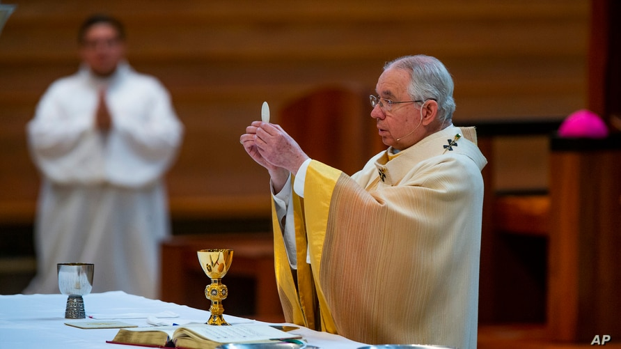 FILE - Archbishop Jose H. Gomez celebrates the Solemnity of the Most Holy Trinity Mass at the Cathedral of Our Lady of the Angels in downtown Los Angeles, California, June 7, 2020.