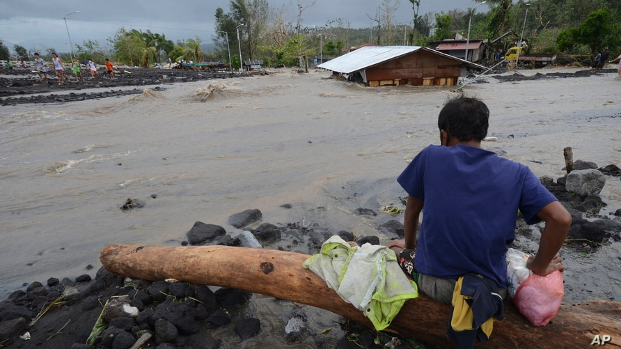 A man looks as floodwaters inundate an area as Typhoon Goni hit Daraga, Albay province, central Philippines, Nov. 1, 2020.