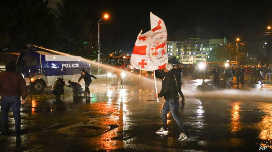 Police use a water cannon against supporters of ex-President Mikhail Saakashvili's United National Movement, protesting parliamentary election results, in Tbilisi, Georgia, Nov. 8, 2020.