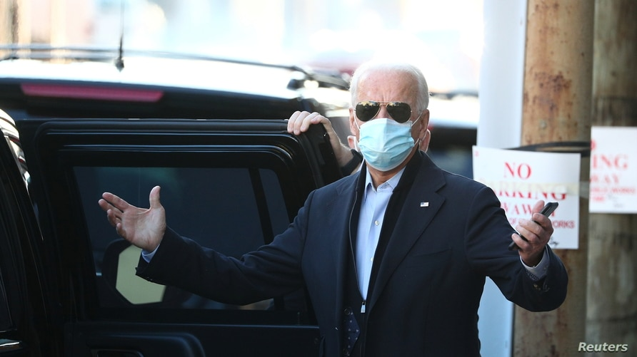 U.S. President-elect Joe Biden reacts to a journalist's question while exiting The Queen theatre following a virtual meeting with frontline health care workers in Wilmington, Delaware, Nov. 18, 2020.