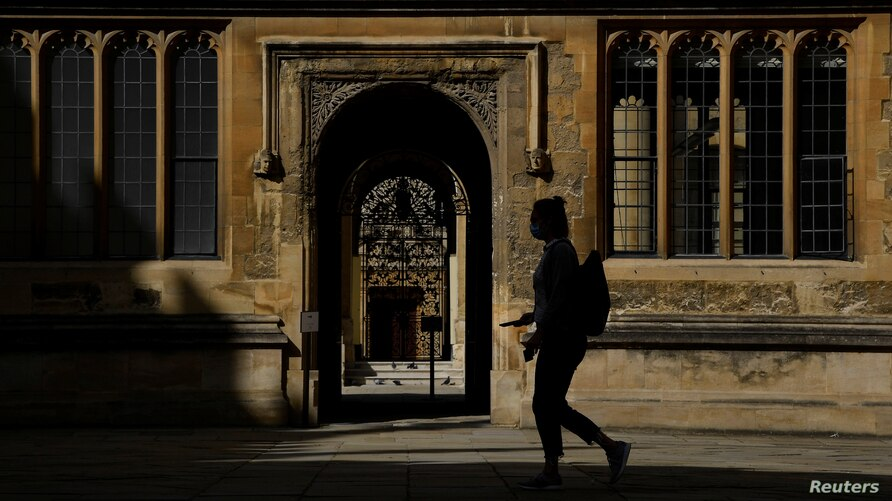 FILE - A student walks on the campus of Oxford University, amid the coronavirus pandemic, in Oxford, Britain, Sept. 17, 2020.